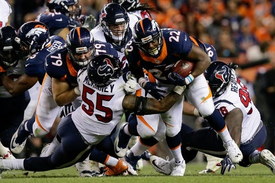 Oct 24, 2016; Denver, CO, USA; Denver Broncos running back C.J. Anderson (22) runs the ball as offensive guard Michael Schofield (79) defends against Houston Texans inside linebacker Benardrick McKinney (55) in the third quarter at Sports Authority Field at Mile High. Mandatory Credit: Isaiah J. Downing-USA TODAY Sports