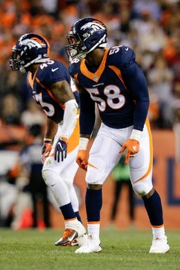 Oct 24, 2016; Denver, CO, USA; Denver Broncos outside linebacker Von Miller (58) and strong safety T.J. Ward (43) in the third quarter against the Houston Texans at Sports Authority Field at Mile High. Mandatory Credit: Isaiah J. Downing-USA TODAY Sports