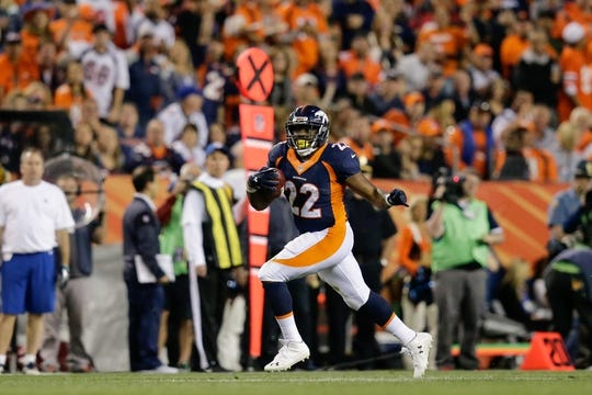 Oct 24, 2016; Denver, CO, USA; Denver Broncos running back C.J. Anderson (22) runs the ball in the third quarter against the Houston Texans at Sports Authority Field at Mile High. Mandatory Credit: Isaiah J. Downing-USA TODAY Sports