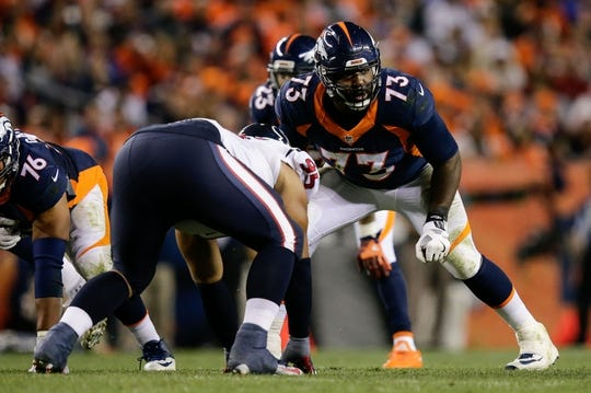 Oct 24, 2016; Denver, CO, USA; Denver Broncos offensive tackle Russell Okung (73) lines up against Houston Texans defensive end Christian Covington (95) in the third quarter at Sports Authority Field at Mile High. Mandatory Credit: Isaiah J. Downing-USA TODAY Sports