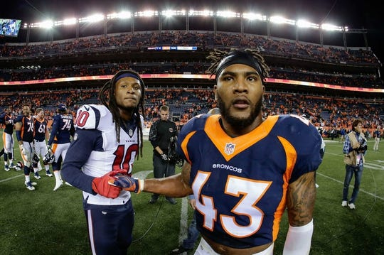 Oct 24, 2016; Denver, CO, USA; Houston Texans wide receiver DeAndre Hopkins (10) and Denver Broncos strong safety T.J. Ward (43) greet each other after the game at Sports Authority Field at Mile High. Mandatory Credit: Isaiah J. Downing-USA TODAY Sports