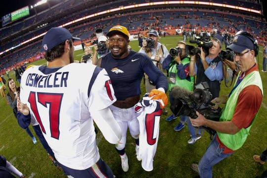 Oct 24, 2016; Denver, CO, USA; Houston Texans quarterback Brock Osweiler (17) and Denver Broncos outside linebacker Von Miller (58) greet each other after the game at Sports Authority Field at Mile High. Mandatory Credit: Isaiah J. Downing-USA TODAY Sports