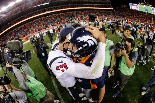 Oct 24, 2016; Denver, CO, USA; Houston Texans quarterback Brock Osweiler (17) and Denver Broncos quarterback Trevor Siemian (13) greet each other after the game at Sports Authority Field at Mile High. The Broncos won 27-9. Mandatory Credit: Isaiah J. Downing-USA TODAY Sports