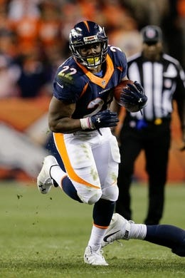 Oct 24, 2016; Denver, CO, USA; Denver Broncos running back C.J. Anderson (22) runs the ball in the fourth quarter against the Houston Texans at Sports Authority Field at Mile High. Mandatory Credit: Isaiah J. Downing-USA TODAY Sports