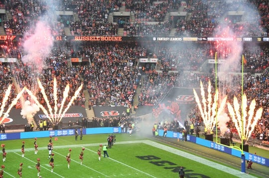 Oct 30, 2016; London, United Kingdom; Cincinnati Bengals center Russell Bodine (61) is introduced during game 17 of the NFL International Series against the Washington Redskins at Wembley Stadium. The Redskins and Bengals tied 27-27 tie. Mandatory Credit: Kirby Lee-USA TODAY Sports