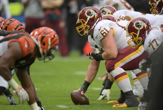 Oct 30, 2016; London, United Kingdom; General view of the line of scrimmage as Washington Redskins guard Spencer Long (61) snaps the ball against the Cincinnati Bengals during game 17 of the NFL International Series at Wembley Stadium. Mandatory Credit: Kirby Lee-USA TODAY Sports