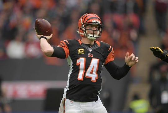 Oct 30, 2016; London, United Kingdom; Cincinnati Bengals quarterback Andy Dalton (14) throws a pass against the Washington Redskins during game 17 of the NFL International Series at Wembley Stadium. The Redskins and Bengals tied 27-27 tie. Mandatory Credit: Kirby Lee-USA TODAY Sports