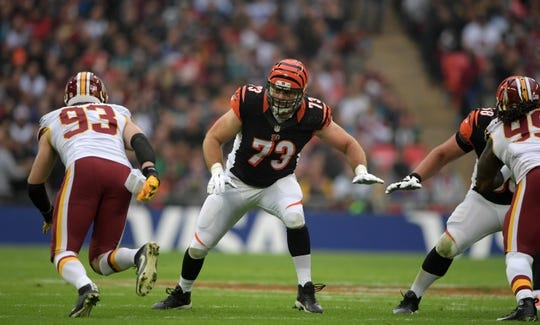 Oct 30, 2016; London, United Kingdom; Cincinnati Bengals tackle Eric Winston (73) defends against Washington Redskins defensive end Trent Murphy (93) during game 17 of the NFL International Series at Wembley Stadium. The Redskins and Bengals tied 27-27 tie. Mandatory Credit: Kirby Lee-USA TODAY Sports