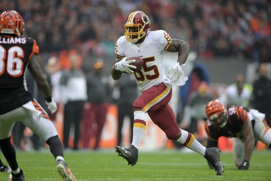 Oct 30, 2016; London, United Kingdom; Washington Redskins tight end Vernon Davis (85) carries the ball against the Cincinnati Bengals during game 17 of the NFL International Series at Wembley Stadium. Mandatory Credit: Kirby Lee-USA TODAY Sports