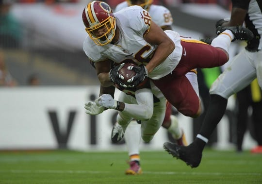Oct 30, 2016; London, United Kingdom; Washington Redskins tight end Jordan Reed (86) dives into the end zone on a 23-yard touchdown reception in the third quarter against the Cincinnati Bengals during game 17 of the NFL International Series at Wembley Stadium. The Redskins and Bengals tied 27-27 tie. Mandatory Credit: Kirby Lee-USA TODAY Sports