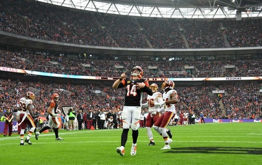 Oct 30, 2016; London, United Kingdom; Cincinnati Bengals quarterback Andy Dalton (14) celebrates after scoring on a 1-yard touchdown run in the third quarter during game 17 of the NFL International Series at Wembley Stadium. The Redskins and Bengals tied 27-27 tie. Mandatory Credit: Kirby Lee-USA TODAY Sports