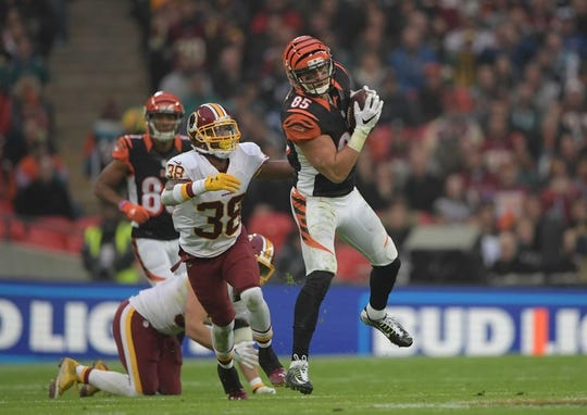 Oct 30, 2016; London, United Kingdom; Cincinnati Bengals tight end Tyler Eifert (85) is defended by Washington Redskins cornerback Kendall Fuller (38) during game 17 of the NFL International Series at Wembley Stadium. The Redskins and Bengals tied 27-27 tie. Mandatory Credit: Kirby Lee-USA TODAY Sports