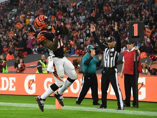 Oct 30, 2016; London, United Kingdom;Cincinnati Bengals running back Jeremy Hill (32) celebrates after scoring on a 1-yard touchdown run in the fourth quarter against the Washington Redskins during game 17 of the NFL International Series at Wembley Stadium. The Redskins and Bengals tied 27-27 tie. Mandatory Credit: Kirby Lee-USA TODAY Sports