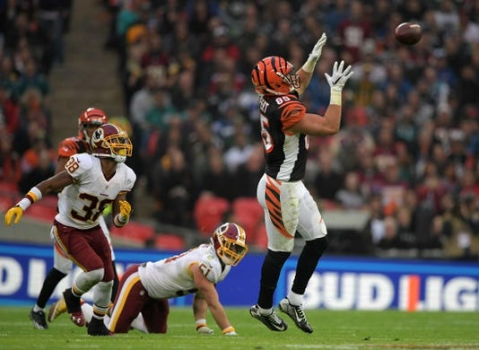 Oct 30, 2016; London, United Kingdom; Cincinnati Bengals tight end Tyler Eifert (85) catches a pass against the Washington Redskins during game 17 of the NFL International Series at Wembley Stadium. The Redskins and Bengals tied 27-27 tie. Mandatory Credit: Kirby Lee-USA TODAY Sports