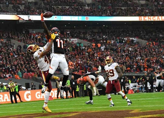 Oct 30, 2016; London, United Kingdom; Cincinnati Bengals wide receiver Brandon LaFell (11) attempts to catch a pass while defended by Washington Redskins cornerback Quinton Dunbar (47) during game 17 of the NFL International Series at Wembley Stadium. Dunbar was penalized for pass interference. The Redskins and Bengals tied 27-27 tie. Mandatory Credit: Kirby Lee-USA TODAY Sports