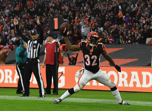 Oct 30, 2016; London, United Kingdom;Cincinnati Bengals running back Jeremy Hill (32) spikes the ball in celebration after scoring on a 1-yard touchdown run in the fourth quarter against the Washington Redskins during game 17 of the NFL International Series at Wembley Stadium. The Redskins and Bengals tied 27-27 tie. Mandatory Credit: Kirby Lee-USA TODAY Sports