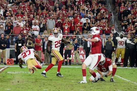 Nov 13, 2016; Glendale, AZ, USA; Arizona Cardinals kicker Chandler Catanzaro (7) kicks a game-winning field goal against the San Francisco 49ers during the during half at University of Phoenix Stadium. The Cardinals won 23-20. Mandatory Credit: Joe Camporeale-USA TODAY Sports