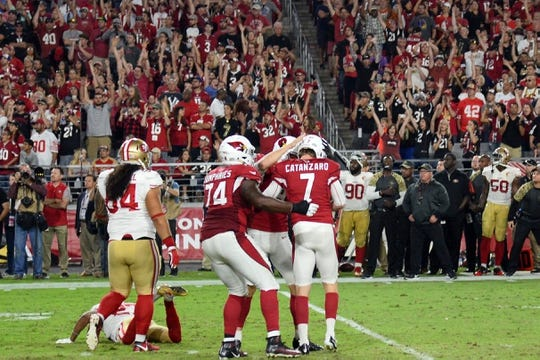 Nov 13, 2016; Glendale, AZ, USA; Arizona Cardinals kicker Chandler Catanzaro (7) celebrates a game-winning field goal against the San Francisco 49ers during the during half at University of Phoenix Stadium. The Cardinals won 23-20. Mandatory Credit: Joe Camporeale-USA TODAY Sports