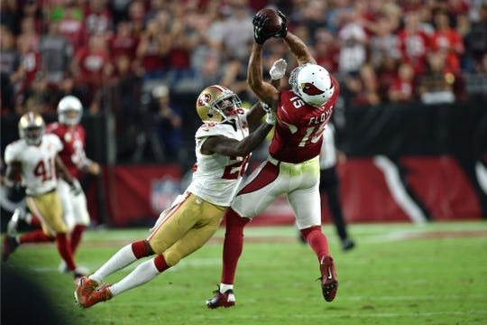 Nov 13, 2016; Glendale, AZ, USA; Arizona Cardinals wide receiver Michael Floyd (15) makes a catch against San Francisco 49ers cornerback Tramaine Brock (26) during the second half at University of Phoenix Stadium. The Cardinals won 23-20. Mandatory Credit: Joe Camporeale-USA TODAY Sports