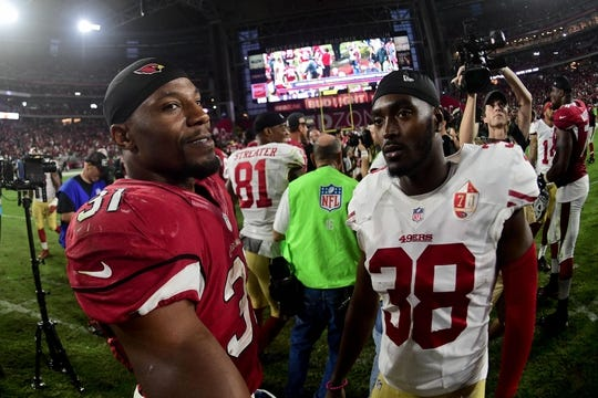 Nov 13, 2016; Glendale, AZ, USA;  Arizona Cardinals running back David Johnson (31) and San Francisco 49ers cornerback JaCorey Shepherd (38) talk after the game at University of Phoenix Stadium. Mandatory Credit: Matt Kartozian-USA TODAY Sports