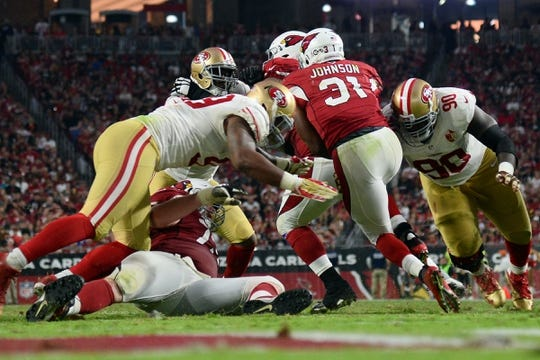 Nov 13, 2016; Glendale, AZ, USA; San Francisco 49ers defensive end Glenn Dorsey (90) tackles Arizona Cardinals running back David Johnson (31) during the second half at University of Phoenix Stadium. The Cardinals won 23-20. Mandatory Credit: Joe Camporeale-USA TODAY Sports