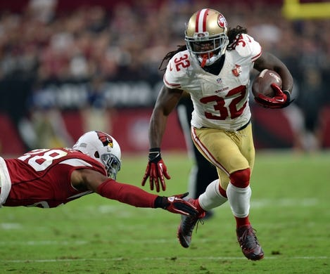 Nov 13, 2016; Glendale, AZ, USA; San Francisco 49ers running back DuJuan Harris (32) runs by Arizona Cardinals cornerback Justin Bethel (28) during the second half at University of Phoenix Stadium. The Cardinals won 23-20. Mandatory Credit: Joe Camporeale-USA TODAY Sports