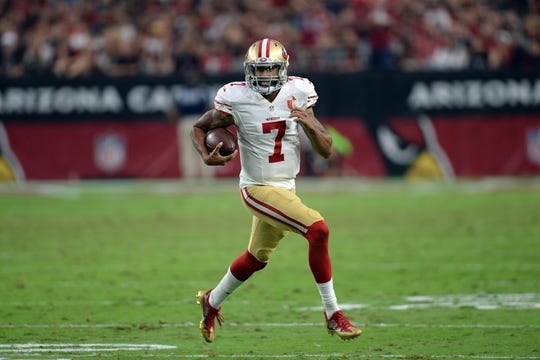 Nov 13, 2016; Glendale, AZ, USA; San Francisco 49ers quarterback Colin Kaepernick (7) runs with the ball against the Arizona Cardinals during the second half at University of Phoenix Stadium. The Cardinals won 23-20. Mandatory Credit: Joe Camporeale-USA TODAY Sports