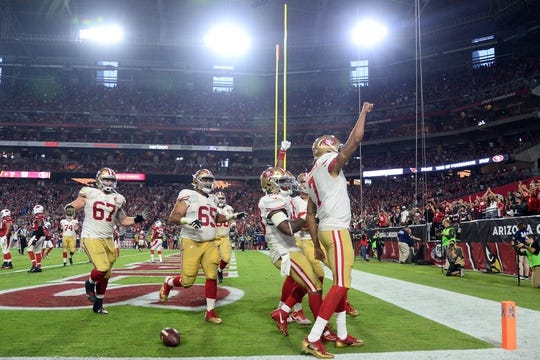 Nov 13, 2016; Glendale, AZ, USA; San Francisco 49ers quarterback Colin Kaepernick (7) celebrates a touchdown against the Arizona Cardinals during the second half at University of Phoenix Stadium. The Cardinals won 23-20. Mandatory Credit: Joe Camporeale-USA TODAY Sports