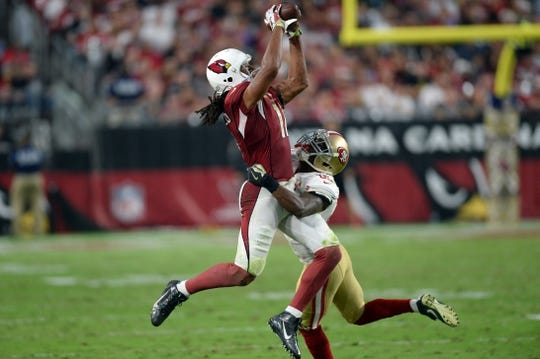 Nov 13, 2016; Glendale, AZ, USA; Arizona Cardinals wide receiver Larry Fitzgerald (11) makes a catch against San Francisco 49ers cornerback Jimmie Ward (25) during the second half at University of Phoenix Stadium. The Cardinals won 23-20. Mandatory Credit: Joe Camporeale-USA TODAY Sports