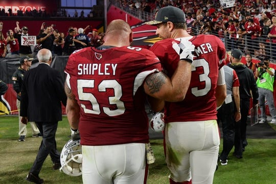 Nov 13, 2016; Glendale, AZ, USA; Arizona Cardinals center A.Q. Shipley (53) and Arizona Cardinals quarterback Carson Palmer (3) leave the field after the second half against the San Francisco 49ers at University of Phoenix Stadium. The Cardinals won 23-20. Mandatory Credit: Joe Camporeale-USA TODAY Sports