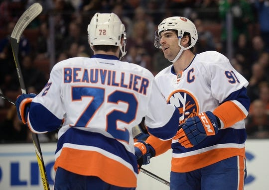 November 22, 2016; Anaheim, CA, USA;  New York Islanders center John Tavares (91) celebrates with left wing Anthony Beauvillier (72) his goal scored against the Anaheim Ducks during the first period at Honda Center. Mandatory Credit: Gary A. Vasquez-USA TODAY Sports