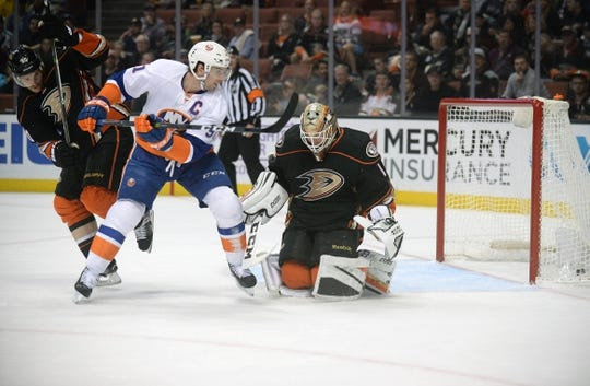November 22, 2016; Anaheim, CA, USA;  New York Islanders center John Tavares (91) deflects the puck in for a goal against Anaheim Ducks goalie Jonathan Bernier (1) during the first period at Honda Center. Mandatory Credit: Gary A. Vasquez-USA TODAY Sports