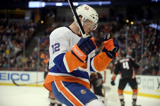 November 22, 2016; Anaheim, CA, USA;  New York Islanders left wing Josh Bailey (12) celebrates his goal scored against the Anaheim Ducks during the first period at Honda Center. Mandatory Credit: Gary A. Vasquez-USA TODAY Sports