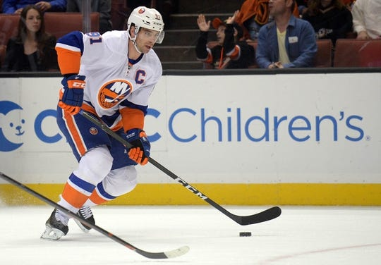 November 22, 2016; Anaheim, CA, USA;  New York Islanders center John Tavares (91) moves the puck against the Anaheim Ducks during the first period at Honda Center. Mandatory Credit: Gary A. Vasquez-USA TODAY Sports