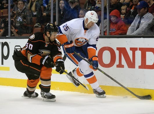 November 22, 2016; Anaheim, CA, USA;  New York Islanders left wing Jason Chimera (25) plays for the puck against Anaheim Ducks center Antoine Vermette (50) during the first period at Honda Center. Mandatory Credit: Gary A. Vasquez-USA TODAY Sports