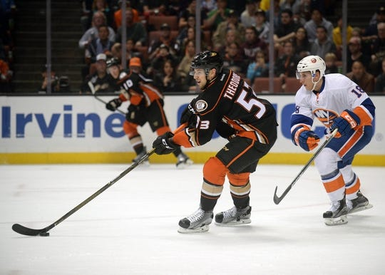 November 22, 2016; Anaheim, CA, USA;  Anaheim Ducks defenseman Shea Theodore (53) moves the puck ahead of New York Islanders right wing Ryan Strome (18) during the first period at Honda Center. Mandatory Credit: Gary A. Vasquez-USA TODAY Sports
