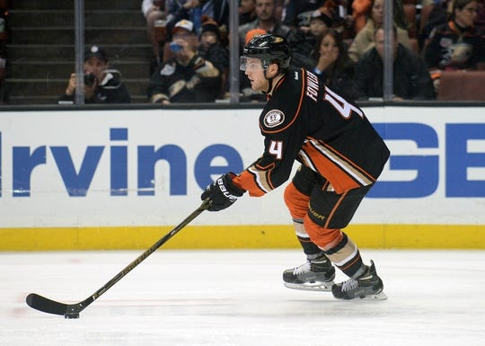 November 22, 2016; Anaheim, CA, USA;  Anaheim Ducks defenseman Cam Fowler (4) moves the puck against the New York Islanders during the first period at Honda Center. Mandatory Credit: Gary A. Vasquez-USA TODAY Sports