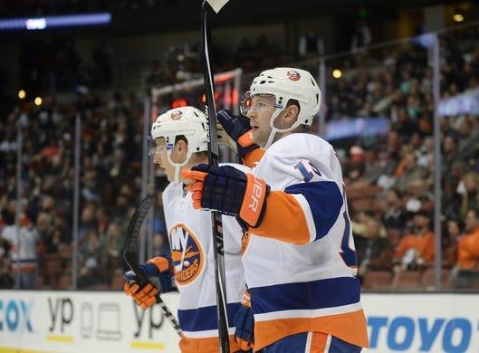 November 22, 2016; Anaheim, CA, USA;  New York Islanders left wing Josh Bailey (12) celerbates his goal scored against the Anaheim Ducks during the first period at Honda Center. Mandatory Credit: Gary A. Vasquez-USA TODAY Sports
