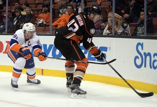 November 22, 2016; Anaheim, CA, USA;  Anaheim Ducks defenseman Josh Manson (42) plays for the puck against New York Islanders center John Tavares (91) during the first period at Honda Center. Mandatory Credit: Gary A. Vasquez-USA TODAY Sports