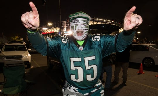 """Nov 28, 2016; Philadelphia, PA, USA; Philadelphia Eagles fan Gene """"the face"""" Olewnik cheers outside Lincoln Financial Field before a game against the Green Bay Packers. Mandatory Credit: Bill Streicher-USA TODAY Sports"""