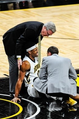 Dec 5, 2016; Iowa City, IA, USA; Injured Iowa Hawkeyes forward Ahmad Wagner (0) is assisted by head coach Fran McCaffery (left) during the second half against the Stetson Hatters at Carver-Hawkeye Arena. Mandatory Credit: Jeffrey Becker-USA TODAY Sports