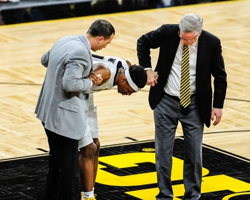 Dec 5, 2016; Iowa City, IA, USA; Injured Iowa Hawkeyes forward Ahmad Wagner (0) is assisted by head coach Fran McCaffery (right) during the second half against the Stetson Hatters at Carver-Hawkeye Arena. Mandatory Credit: Jeffrey Becker-USA TODAY Sports