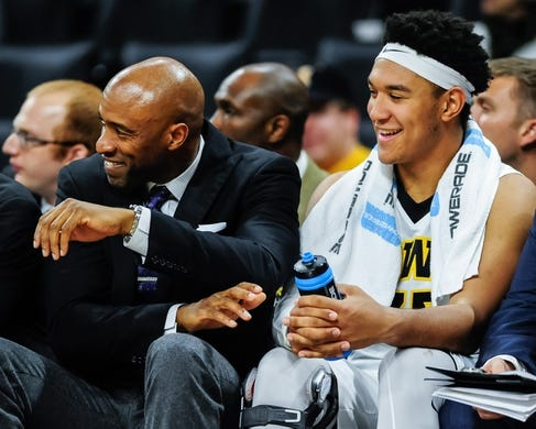 Dec 5, 2016; Iowa City, IA, USA; Iowa Hawkeyes assistant coach Andrew Francis and forward Cordell Pemsl (35) smile on the bench during the second half against the Stetson Hatters at Carver-Hawkeye Arena. Iowa won 95-68. Mandatory Credit: Jeffrey Becker-USA TODAY Sports