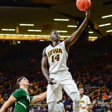 Dec 5, 2016; Iowa City, IA, USA; Iowa Hawkeyes guard Peter Jok (14) goes to the basket as Stetson Hatters guard Angel Rivera (5) looks on during the second half at Carver-Hawkeye Arena. Iowa won 95-68. Mandatory Credit: Jeffrey Becker-USA TODAY Sports