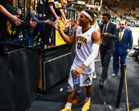 Dec 5, 2016; Iowa City, IA, USA; Injured Iowa Hawkeyes forward Ahmad Wagner (0) walks off the court to greet fans after the game against the Stetson Hatters at Carver-Hawkeye Arena. Iowa won 95-68. Mandatory Credit: Jeffrey Becker-USA TODAY Sports