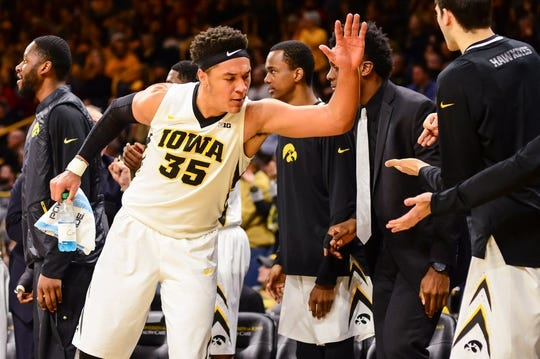 Dec 5, 2016; Iowa City, IA, USA; Iowa Hawkeyes forward Cordell Pemsl (35) and the Hawkeyes bench celebrate during the second half against the Iowa State Cyclones at Carver-Hawkeye Arena. Iowa won 78-64. Mandatory Credit: Jeffrey Becker-USA TODAY Sports