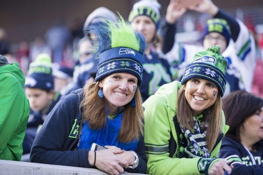 Jan 1, 2017; Santa Clara, CA, USA; Shannon Aiken (left) and Jennifer Audette (right) from Seattle to cheer on their team before the game against the San Francisco 49ers at Levis Stadium. Mandatory Credit: Neville E. Guard-USA TODAY Sports