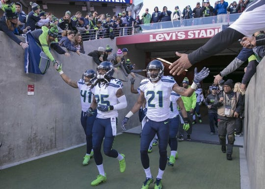 Jan 1, 2017; Santa Clara, CA, USA; Seattle Seahawks cornerback Richard Sherman (25) and cornerback DeAndre Elliott (21) and linebacker Dewey McDonald (41) acknowledge fans as they come onto the field before the start of the game against the San Francisco 49ers at Levis Stadium. Mandatory Credit: Neville E. Guard-USA TODAY Sports
