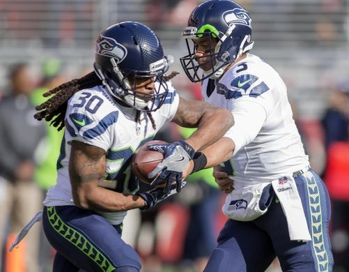 Jan 1, 2017; Santa Clara, CA, USA; Seattle Seahawks quarterback Russell Wilson (3) hands off to running back J.D. McKissic (30) during warm ups before the start of the game against the San Francisco 49ers at Levis Stadium. Mandatory Credit: Neville E. Guard-USA TODAY Sports