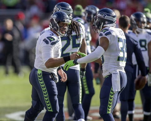 Jan 1, 2017; Santa Clara, CA, USA; Seattle Seahawks quarterback Russell Wilson (3) and cornerback DeShawn Shead (35) before the start of the game against the San Francisco 49ers at Levis Stadium. Mandatory Credit: Neville E. Guard-USA TODAY Sports